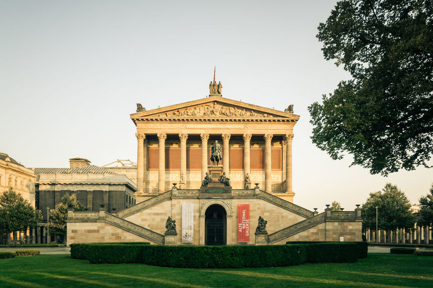 Old National Gallery / Alte Nationalgalerie at Museum Island Berlin shows collections of collection of Neoclassical, Romantic, Biedermeier, Impressionist and early Modernist artwork Architecture Art Berlin Berlin Mitte Berlin Photography Building Exterior Culture Day Entrance Façade Famous Place Gallery Historical Building History Museum Museumsinsel Stairs Statue Stüler Travel Destinations Tree