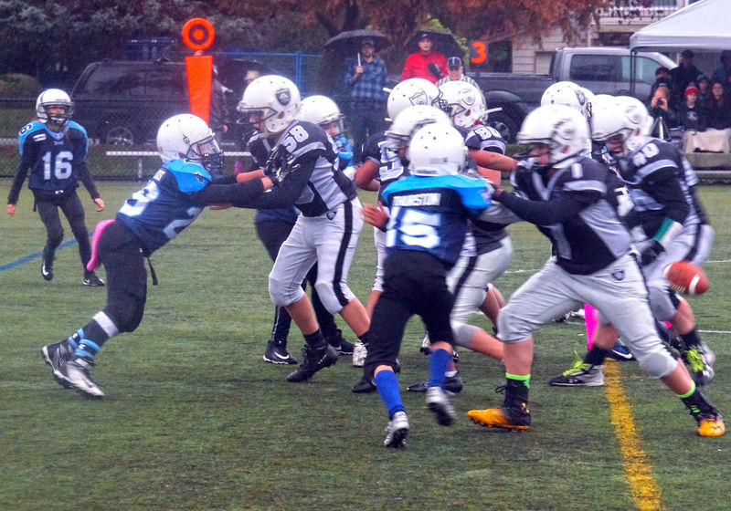 Junior football at Mimoru Park in Richmond B.C. Canada Sports Clothing Activity Competition Competitive Sport Sports Uniform Stadium Sports Helmet Sportsman Headwear Junior Football Richmond BC Playing Field Athlete Togetherness Canada B.C Sports Team