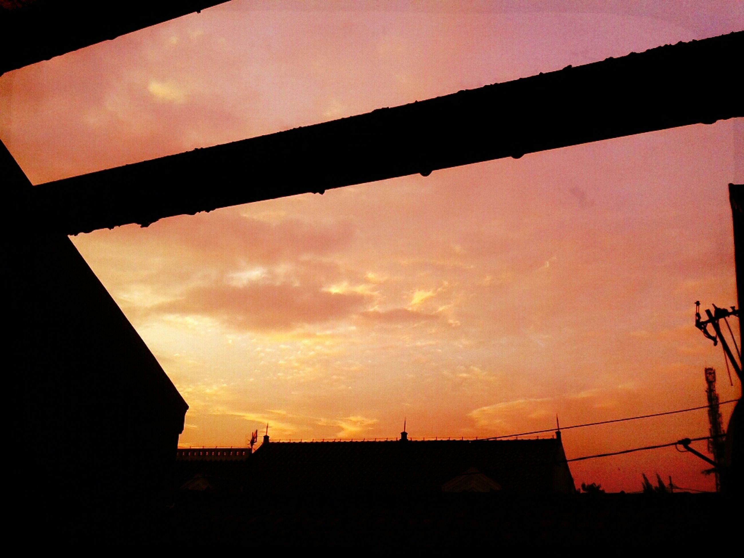 architecture, built structure, sunset, building exterior, silhouette, sky, low angle view, orange color, cloud - sky, building, house, residential structure, cloud, residential building, dusk, outdoors, no people, city, dark, nature