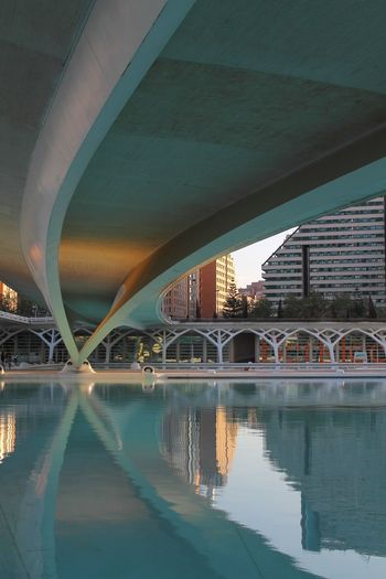 Arch Architectural Column Architecture Below Bridge Bridge - Man Made Structure Building Exterior Built Structure City Connection Covered Bridge Day Footbridge Illuminated Modern No People Outdoors Reflection River Transportation Travel Travel Destinations Underneath Water Waterfront
