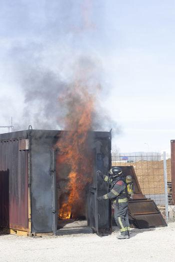 Firefighter Extinguishing Burning Building