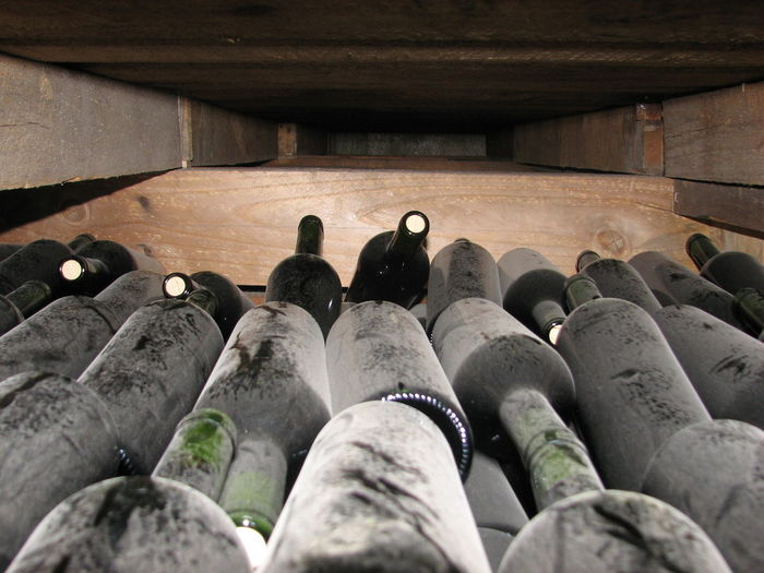 Close-up of bottles at winery
