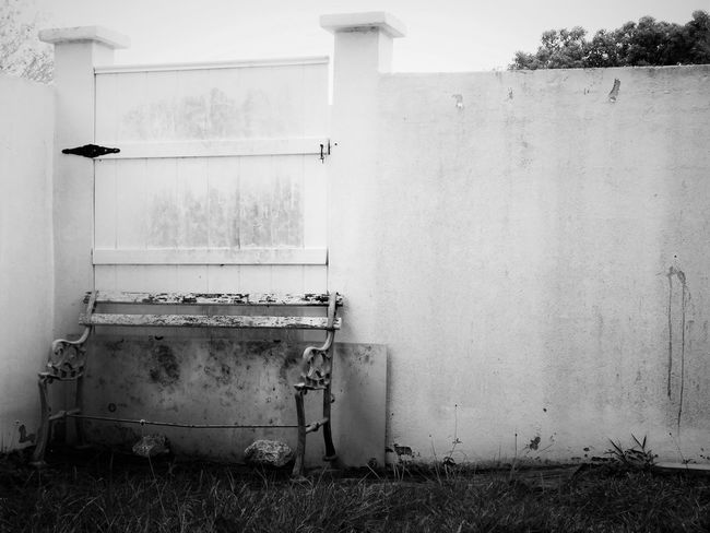 Architecture Bench Black And White Blackandwhite Broken Broken Beauty Broken Down Building Exterior Built Structure Bw Closed Gate Day Dirty Dirty Wall Exterior Façade Gate Gritty Man Made Object Outdoors Wall Wall - Building Feature Weathered White Wall Monochrome Photography