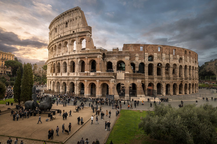 Group of people in front of colosseum