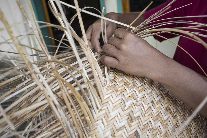 Midsection of person working in basket