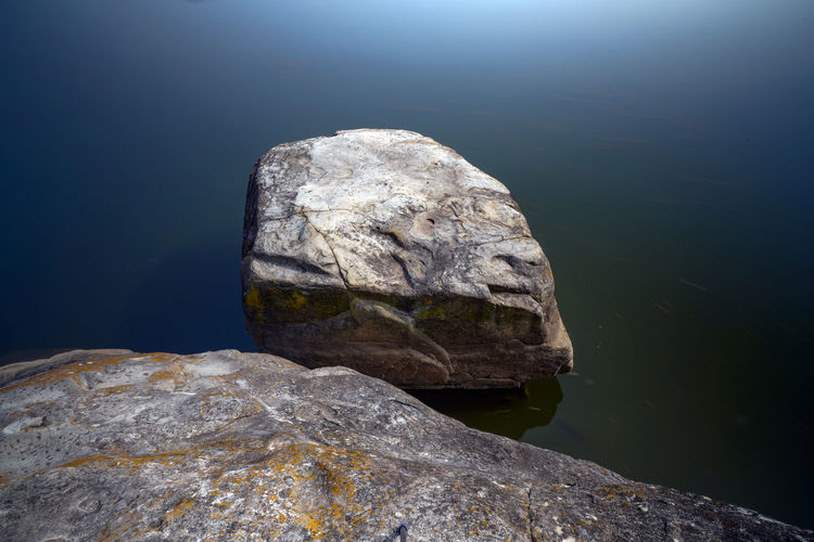 Close-up of rock formation in lake
