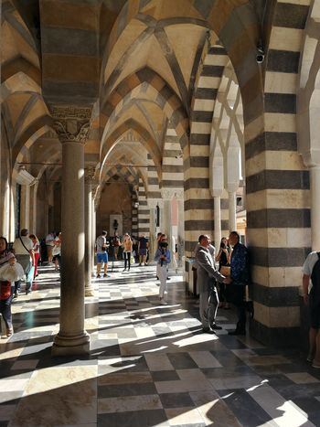 Group Of People Architecture Built Structure Arch Architectural Column Large Group Of People Real People Crowd Women Men Building Arcade Adult History The Past Sunlight Indoors  Lifestyles Tourism Flooring Duomo Di Amalfi Pórtico Coppia Gay Turisti
