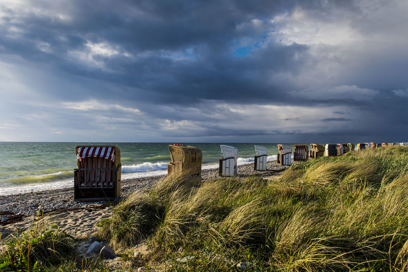 Baltic Sea Baltic Sea Nature Beach Beach Chairs Beauty In Nature Clouds Clouds And Sky Coastline Dark Clouds And Sunshine Dark Clouds Over Water Day Horizon Over Water Horizontal Landscape Nature No People Outdoors Sand Sea Sky Tourism Water