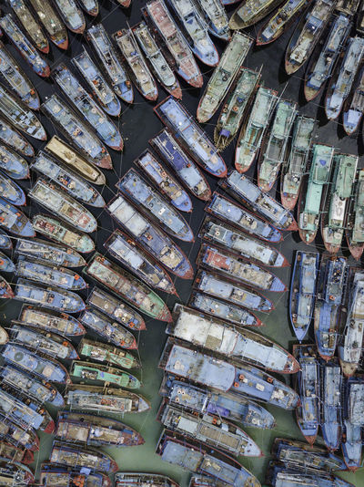 the row of boats Boat Boats Dock Harbor View Harbourside Aerial View Aerial Photography Aerial Shot Pattern High Angle View Repetition In A Row Colorful Fisherman Boat Fishing Boat