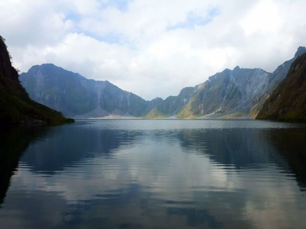 Mount Pinatubo crater lake in Luzon Island, Philippines. Its eruption in 1991 sent more gases to the atmosphere than any other volcano since Krakatoa in 1883, lowering global temperatures in 0.5 degrees Celsius. Crater Lake Water Waterfront Water Reflections Volcano Eruption Outdoors Tranquil Scene Clouds And Sky Volcanic Crater