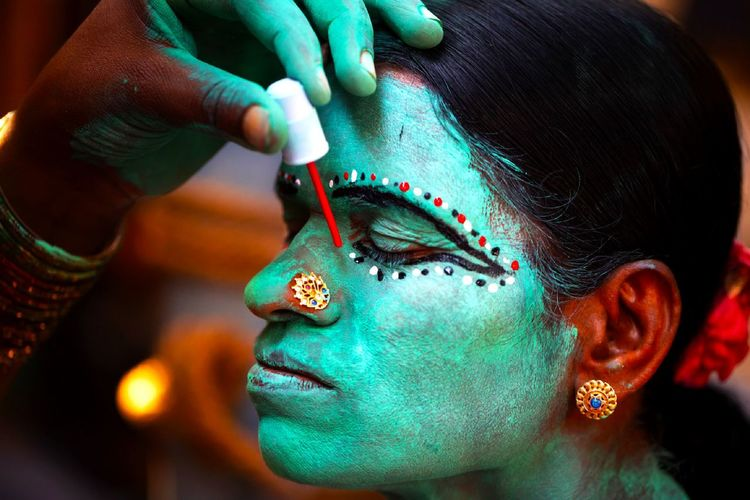 Close-up of woman wearing face paint