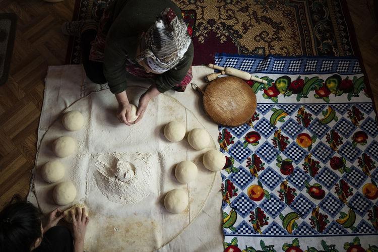 High angle view of woman preparing food at home