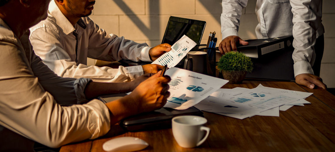 Meeting to discuss ways to develop business to success Table Sitting Business Cup Drink Men Indoors  Mug Communication Holding People Males  Midsection Coffee Cup Corporate Business Adult Office Food And Drink Business Person Meeting Coworker