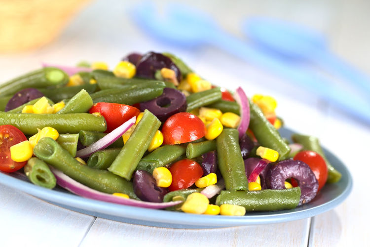 Fresh vegetarian green bean salad with cherry tomatoes, corn, black olives and onion (Selective Focus, Focus one third into the salad)healthy Dish Green Beans Homemade Meal Olive Raw Vegetarian Food Accompaniment Appetizer Bean Cherry Tomatoes Cooked Corn Food Food And Drink Healthy Healthy Eating Onion Salad Steamed  Sweetcorn Tomato Uncooked Vegan Vegetable
