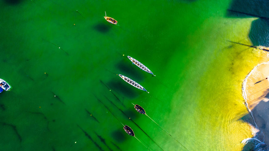High angle view of boats in sea.