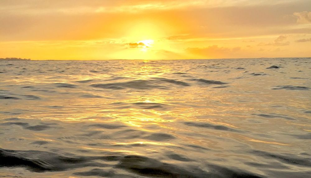 Sunset over still ocean EyeEmNewHere Cloud - Sky Island Tropical Beach Sunsets Peaceful Quiet Calm Seas Calm Still Sunset Sea Sun Beauty In Nature Scenics Nature Orange Color Tranquil Scene Tranquility Reflection Sunlight Sky Outdoors Idyllic Water No People Horizon Over Water Beach Wave