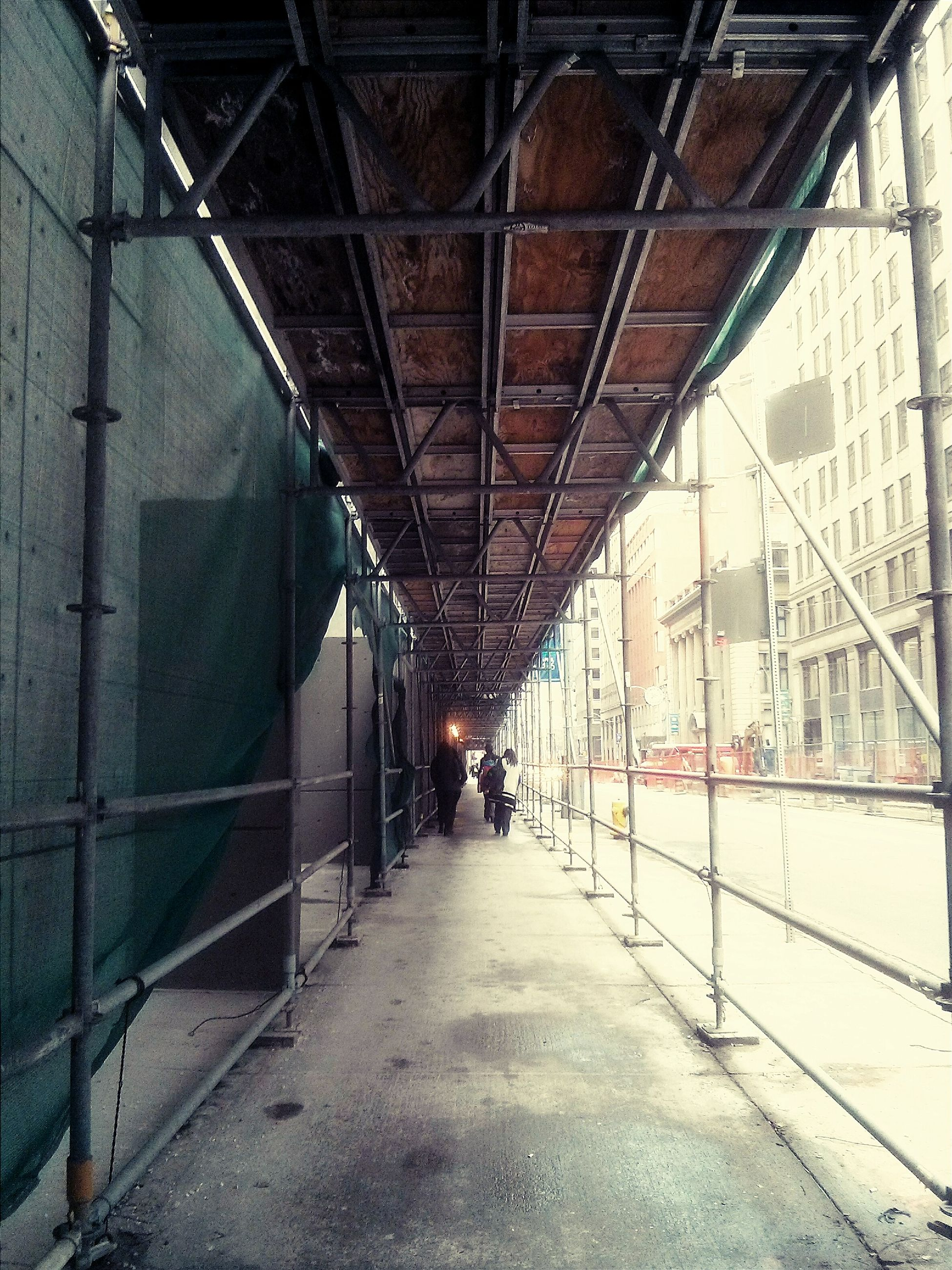 architecture, built structure, the way forward, diminishing perspective, transportation, vanishing point, connection, long, empty, narrow, building exterior, metal, indoors, day, no people, wall - building feature, bridge - man made structure, building, railroad track, walkway