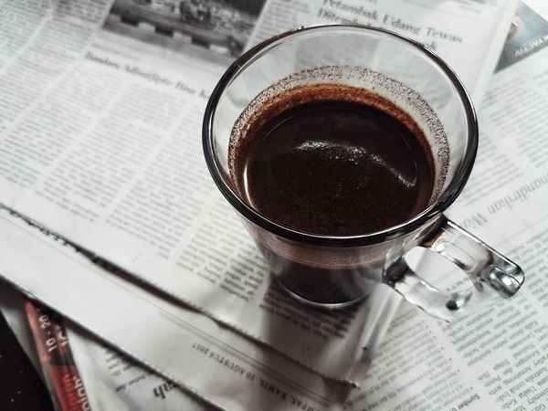 Coffee is good enough to have everyday Newspaper Coffee - Drink Drink Coffee Cup Refreshment Still Life Food And Drink No People Paper Close-up Indoors  Freshness Journalism Day Blackcoffee Darkcoffee Morning Coffee