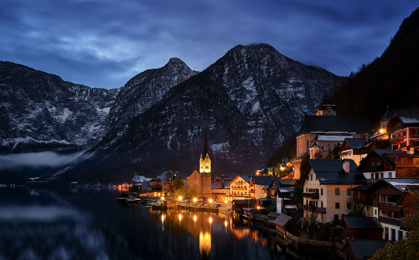 This shot was taken very early in the morning in Hallstatt, Austria. This Amazing little town has quite the reputation in the Photography world for a reason. As always, it's available on the Eyeem Market! Night The Architect - 2016 EyeEm Awards Cityscape City Architecture Travel Lake Mountains Landscape Alps Europe EyeEm Best Shots Cities At Night Fine Art Photography