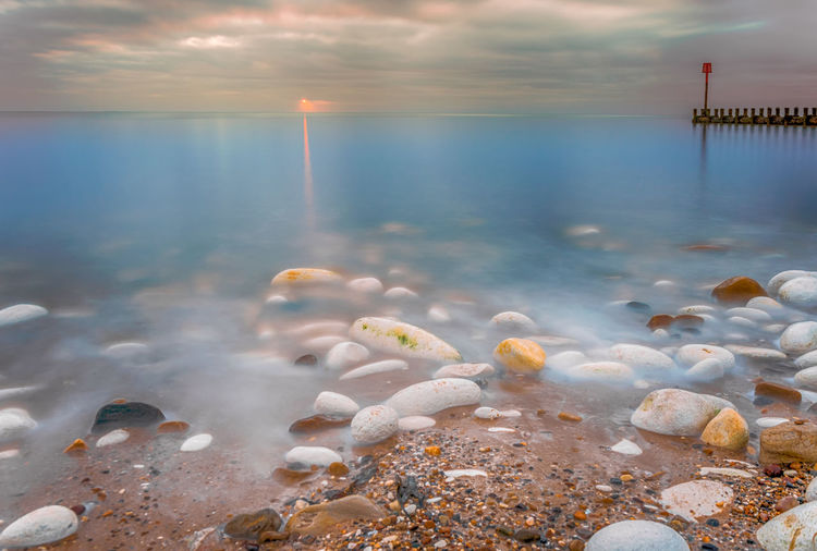 Water Sea Sky Cloud - Sky Nature Scenics - Nature Beauty In Nature Tranquil Scene Tranquility Horizon Over Water Horizon Sunset Motion Beach Land Day No People Rock Outdoors Pollution