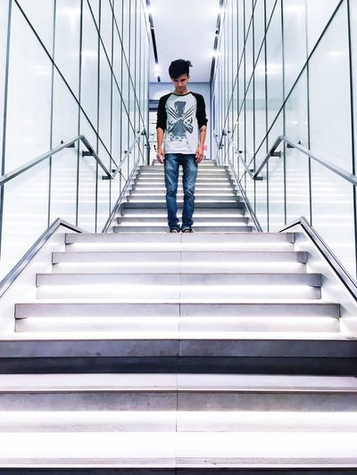 The Architect - 2017 EyeEm Awards Full Length Staircase Steps And Staircases Steps Railing Casual Clothing One Person One Man Only Front View Men The Way Forward Only Men Young Adult Lifestyles Standing Adults Only Real People Adult Day Indoors  The Architect - 2018 EyeEm Awards