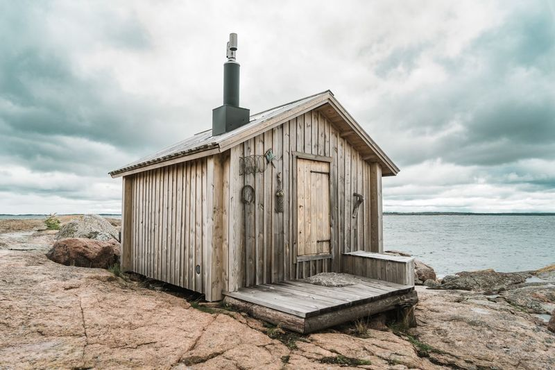 Cabin on an island Cabin Sky Land Beach Cloud - Sky Water Sea Architecture Built Structure Day Building Exterior Hut Tranquility Horizon Over Water Nature Sand No People Outdoors Horizon Beauty In Nature Wood - Material
