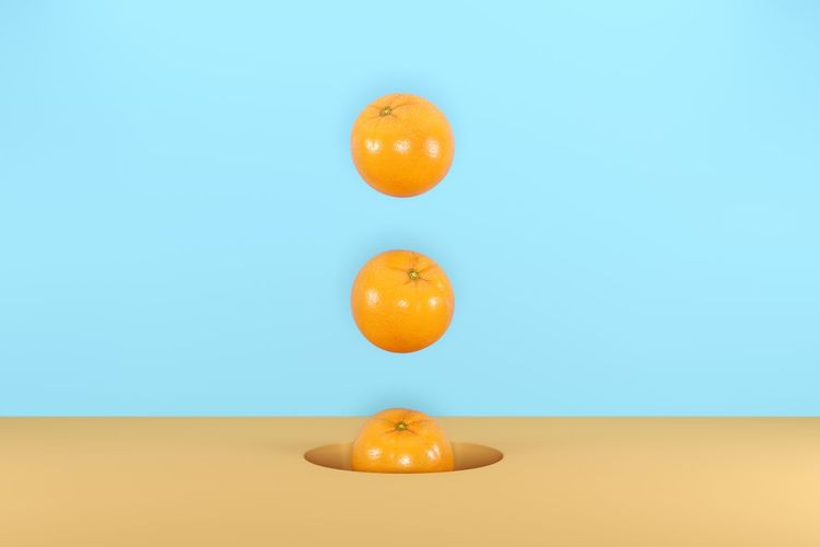 Digital composite image of orange over colored background