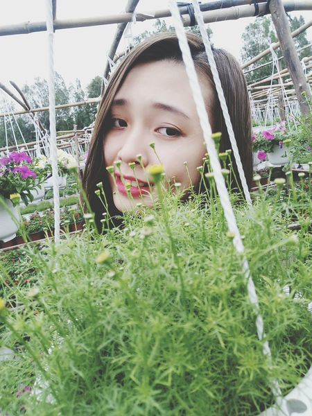 One Girl Only Child One Person Childhood Front View Girls Flower The Week On Eyem HelloEyeEm EyeEm Team Tree Beauty In Nature Green Color Plant Nature Growth Flower Head Smiling Grass People Outdoors Portrait Day Nature Greenhouse