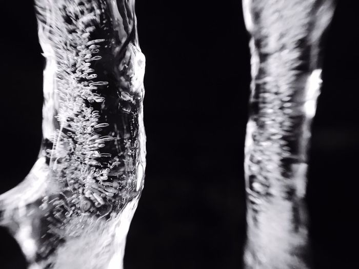Close-up of ice over black background