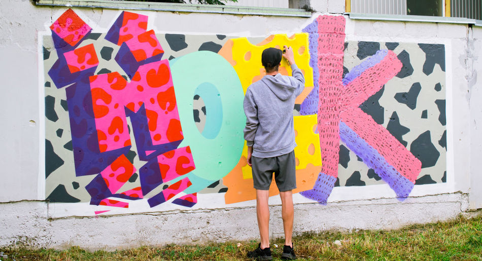 Art Art And Craft Colorful Creativity Graffiti Graffiti Art Graffiti Wall Guy Hands At Work Modern Modern Art Moek Multi Colored Mural Mural Art Outdoor Photography Outdoors Painting People And Places Poster Street Street Photography Young Youth Of Today