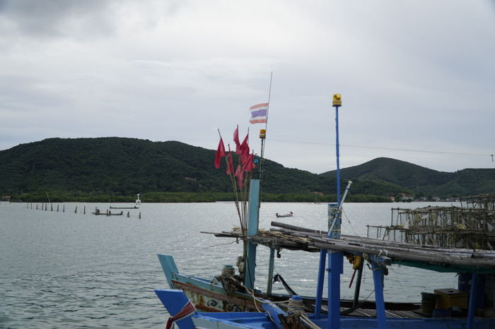 Beauty In Nature Day Flag Flag Pole Moored Mountain Mountain Range National Icon Nature Nautical Vessel No People Outdoors Patriotism Scenics Sea Sky Water
