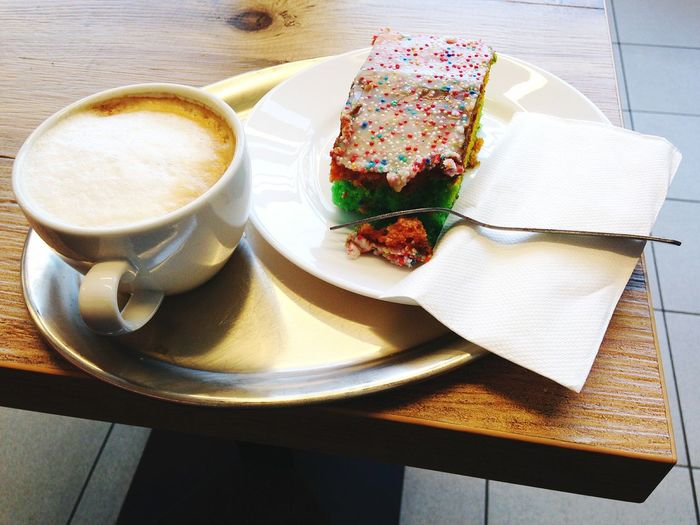 High angle view of coffee with cake on table