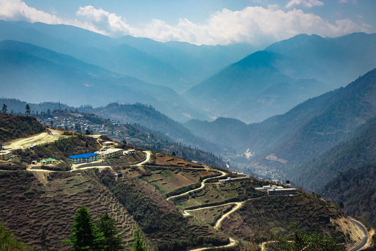 Mountain valley with mountain curvy road and bright blue sky at morning form flat angle