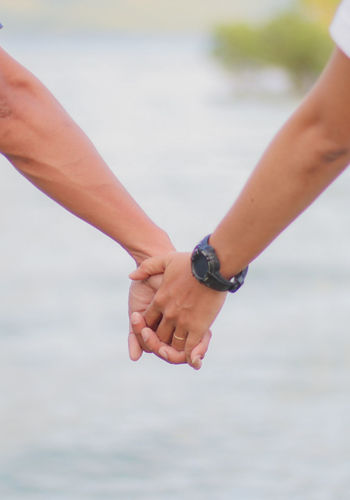 just hold on... Human Body Part Human Hand Two People Togetherness Connection People Couple - Relationship Outdoors Partnership - Teamwork Close-up Unity Canonphotography Selective Focus Bokeh Soft Depth Of Field Focus On Foreground Holdinghands Hold On Focusing The Hands Bokeh Photography Summertime