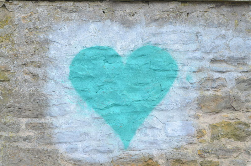 Heart Shape Positive Emotion Art And Craft Love Emotion Creativity No People Green Color Close-up Wall - Building Feature Graffiti Outdoors Paint Day Textured  Craft Symbol Full Frame Rough Turquoise Colored Love Heart
