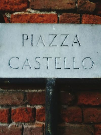 Piazza castello Text Communication Wall - Building Feature Brick Wall Capital Letter Architecture Building Exterior Built Structure Day No People Outdoors Close-up Peschiera Borromeo EyeEmNewHere