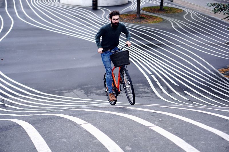 Man riding bicycle on road
