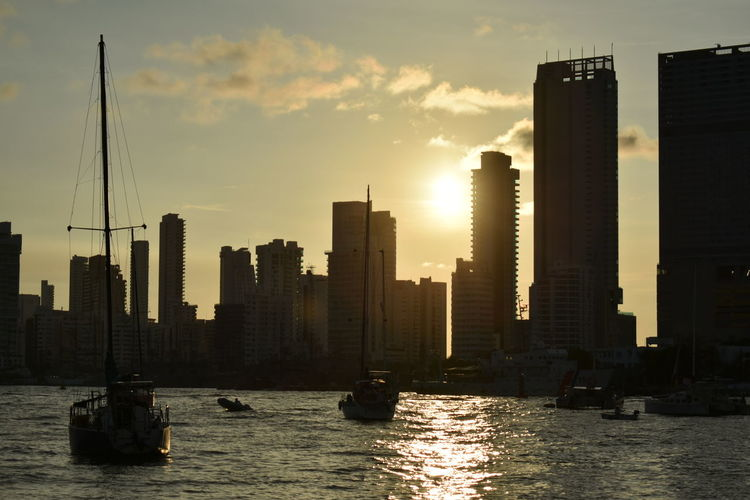 View of skyscrapers at sunset