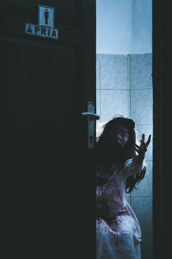 Spooky Woman Gesturing In Bathroom