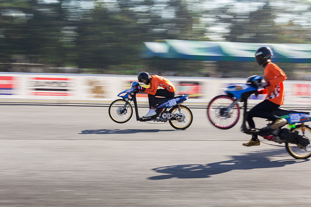 motion, blurred motion, transportation, sport, bicycle, speed, activity, men, competition, riding, lifestyles, ride, real people, cycling, mode of transportation, sports race, land vehicle, on the move, people, two people, outdoors