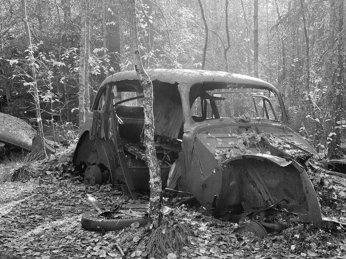 Abandoned vehicle on field