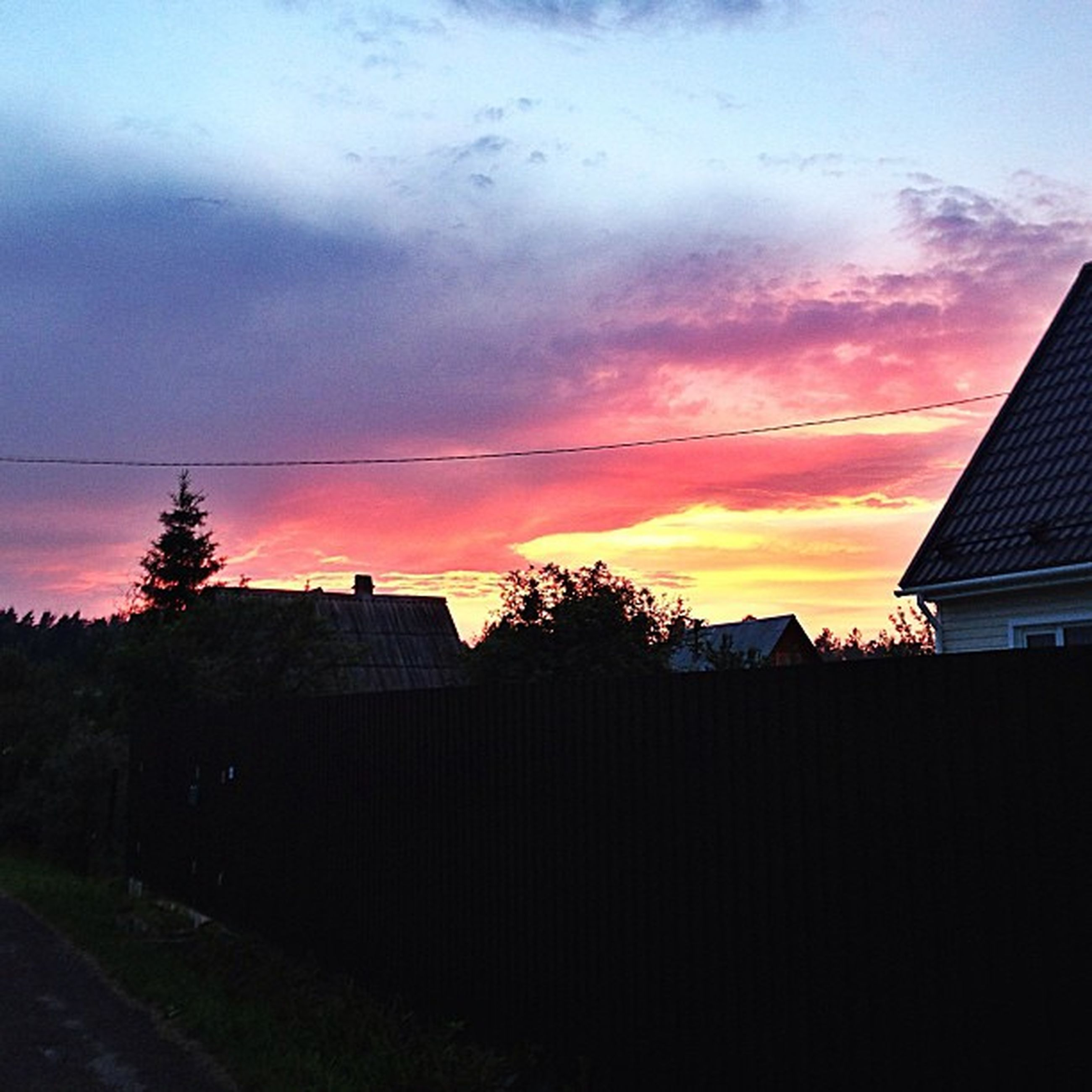 sunset, building exterior, architecture, sky, silhouette, built structure, orange color, house, cloud - sky, power line, tree, residential structure, cloud, low angle view, beauty in nature, electricity pylon, nature, scenics, no people, cloudy