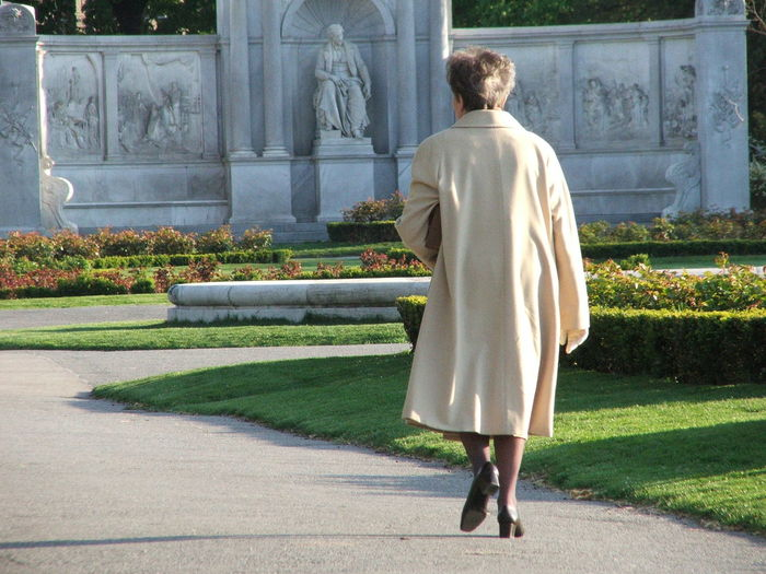 Rear view of woman looking at lawn