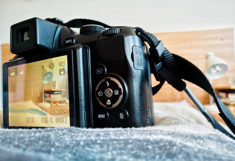 Technology Camera - Photographic Equipment Photography Themes Indoors  Retro Styled Close-up No People Day Digital Single-lens Reflex Camera Photographing Photography Equipment Nikon Nikon Coolpix P90 Nikon Camera Lamp Table Lamp Gadget Model Shooting