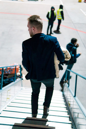 Men Real People Full Length Architecture People Railing Incidental People Walking Lifestyles Travel Leisure Activity Day Focus On Foreground Staircase Group Of People Young Men Rear View Standing Casual Clothing Young Adult Outdoors