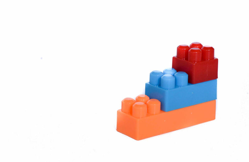 Stack of toys against white background