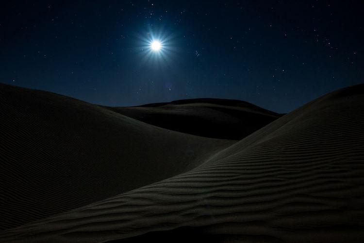 Scenic view of desert at night