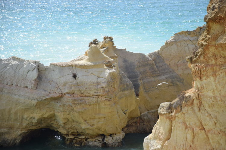 View of rock formations on beach
