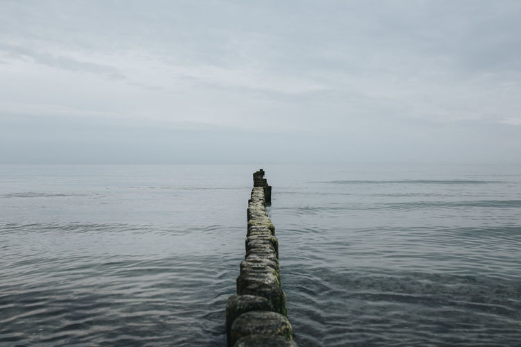 Water Sky Beauty In Nature Tranquil Scene Sea Tranquility Scenics - Nature Nature Horizon Horizon Over Water Day No People Cloud - Sky Wood - Material Outdoors Non-urban Scene Idyllic Post Waterfront Wooden Post Groyne Baltic Sea Shore