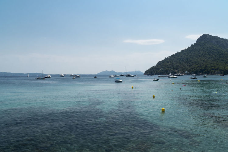 Bay of the Playa de Formentor SPAIN Travel Beauty In Nature Boats Idyllic Landscape Mountain Nature Non-urban Scene Ocean Outdoors Playa De Formentor Sailboat Scenics - Nature Sea Sky Tranquil Scene Tranquility Transportation Travel Destinations Turquoise Colored Water Waterfront Yacht